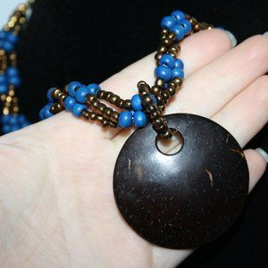 Beautiful gold and blue beaded necklace w coconut